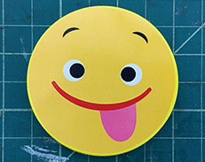opens large image of smiley face toy